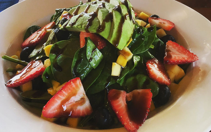 The Sunburst Salad, with avocados and strawberries.
