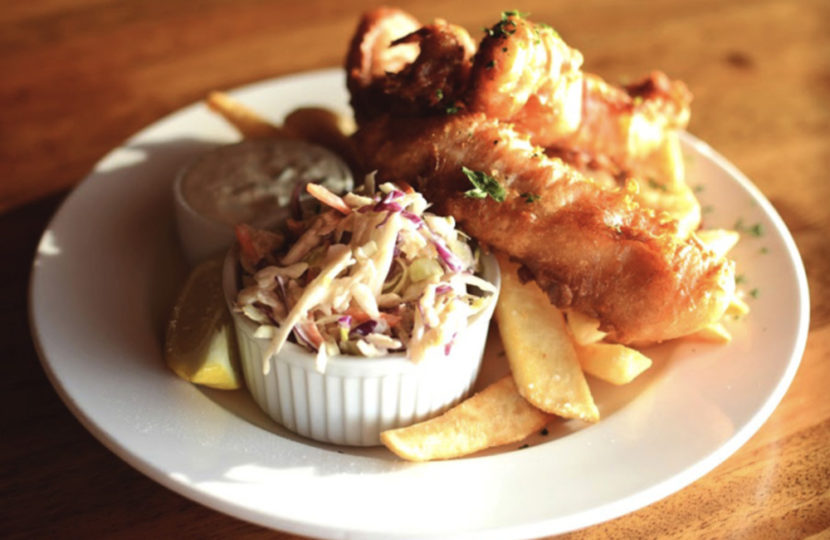 A plate with seafood and fries.